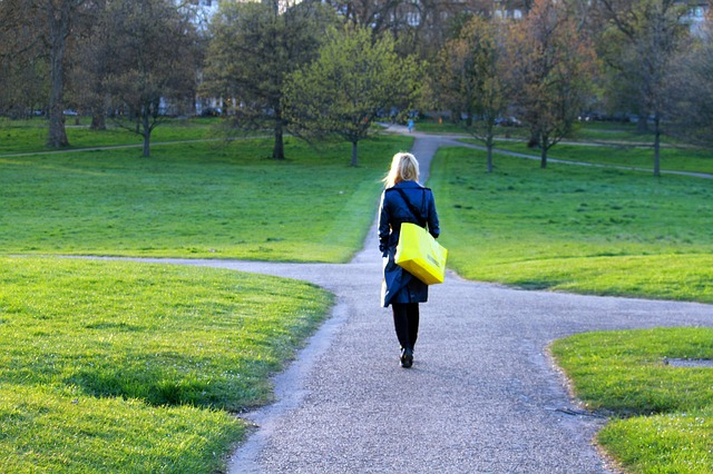 woman employee walking to work to find out about the business sale