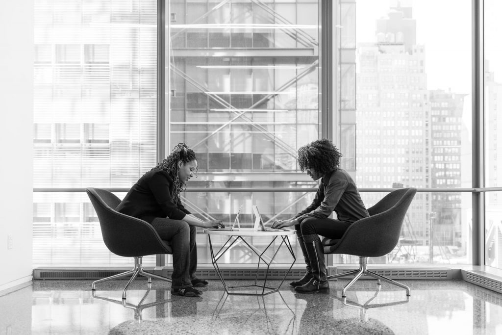 a business broker helping a small business owner sell her business having a meeting