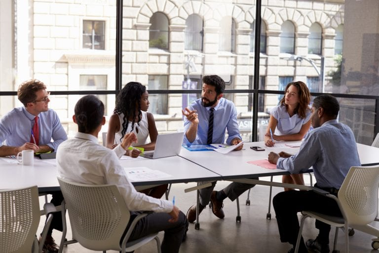 Corporate business team and manager in a meeting about buying a business, close up